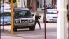 Teen girl smashes car with axe